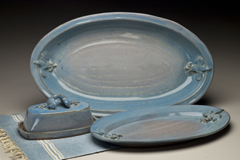 serving bowl, plate and butter dish shown in ship island glaze